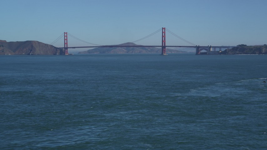 5K stock footage aerial video of flying over the bay approaching the Golden Gate Bridge, San Francisco, California Aerial Stock Footage | DFKSF05_063