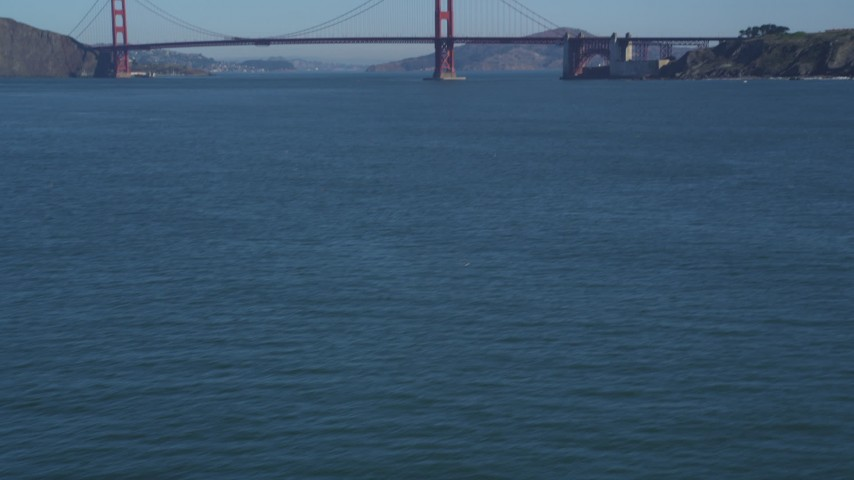 5K stock footage aerial video of tilting from water to reveal the famous Golden Gate Bridge, San Francisco, California Aerial Stock Footage | DFKSF05_064