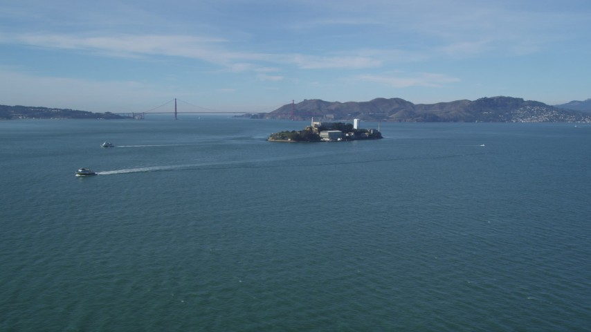 5K stock footage aerial video of iconic Alcatraz with a view of the famous Golden Gate Bridge, San Francisco, California Aerial Stock Footage | DFKSF05_068