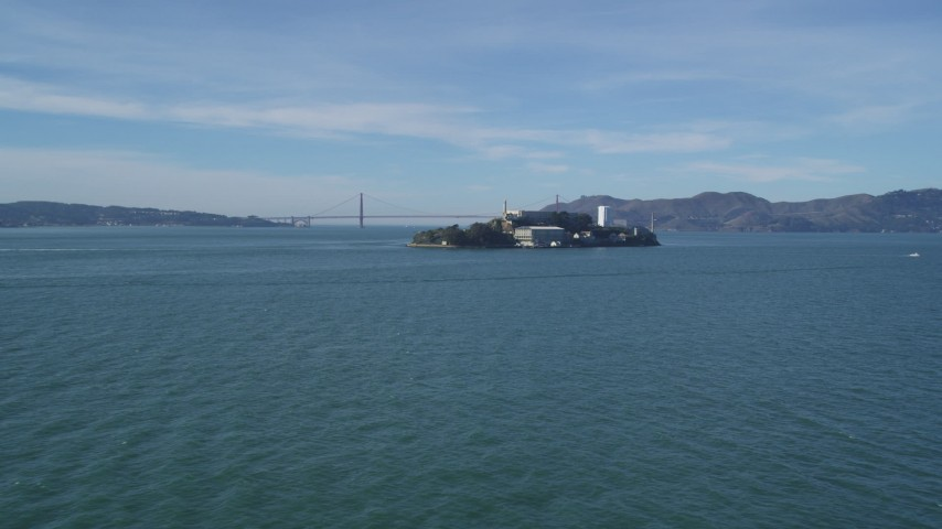 5K stock footage aerial video approach famous Alcatraz prison, Golden Gate Bridge in the background, San Francisco, California Aerial Stock Footage | DFKSF05_069
