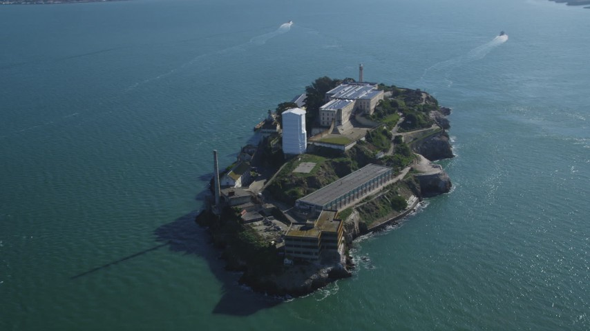 Flying by Alcatraz, views of Downtown Skyline, Bay Bridge, San Francisco, California Aerial Stock Footage | DFKSF05_070