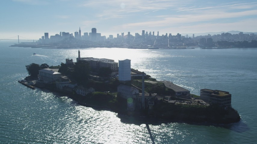 Flying by Alcatraz, views of Downtown Skyline, Bay Bridge, San Francisco, California Aerial Stock Footage | DFKSF05_071