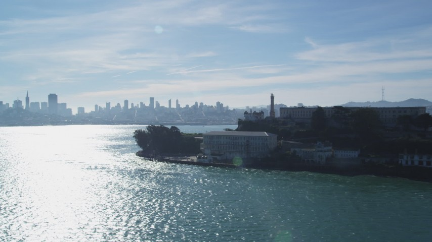 Flying by Alcatraz with views of Downtown Skyline, San Francisco, California Aerial Stock Footage   DFKSF05_072