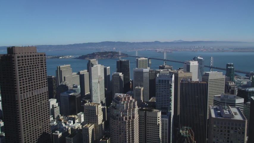 5K aerial video fly over tall skyscrapers to approach the Bay Bridge, Downtown San Francisco, California Aerial Stock Footage | DFKSF05_083