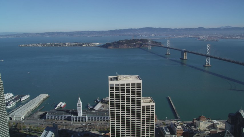 5K aerial video approach Bay Bridge, Yerba Buena Island, Treasure Island, San Francisco, California Aerial Stock Footage | DFKSF05_085