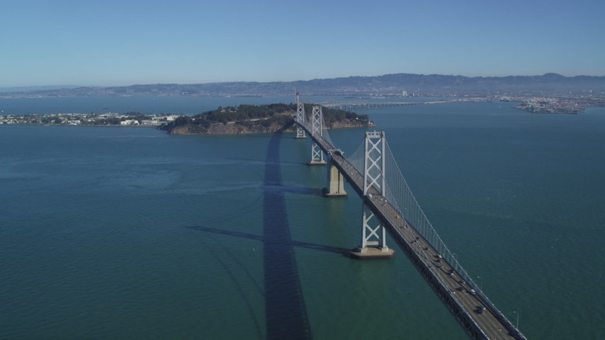 5K aerial video flyby Bay Bridge, view of Yerba Buena, Treasure Islands in San Francisco, California Aerial Stock Footage | DFKSF05_087