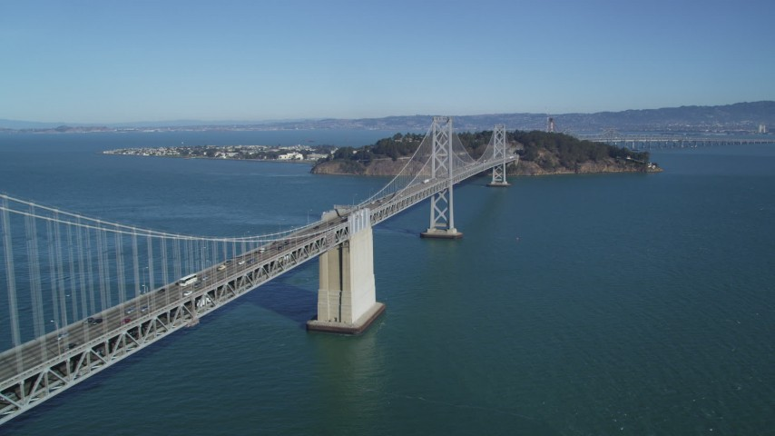 5K stock footage aerial video of flying by the Bay Bridge with light traffic, San Francisco, California Aerial Stock Footage | DFKSF05_088