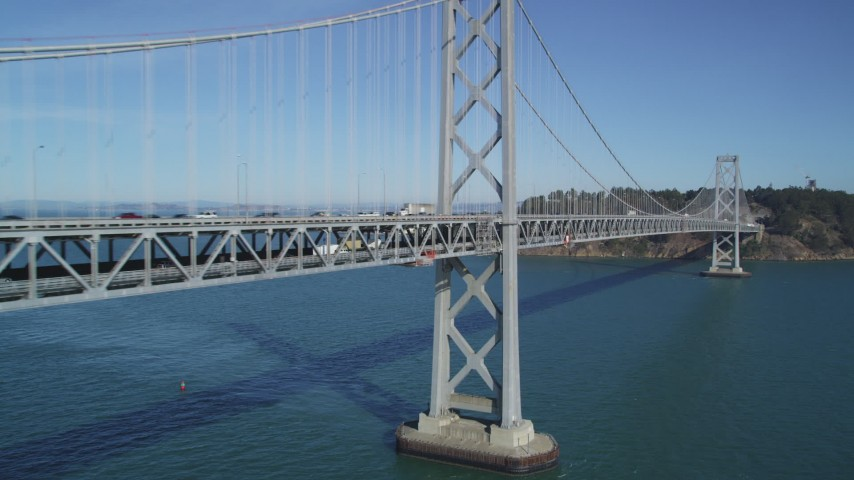 5K stock footage aerial video of flying by the Bay Bridge with light traffic, San Francisco, California Aerial Stock Footage | DFKSF05_089