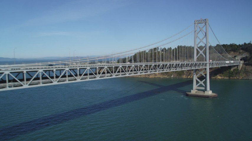 5K stock footage aerial video flyby Bay Bridge near Yerba Buena Island, San Francisco, California Aerial Stock Footage | DFKSF05_090