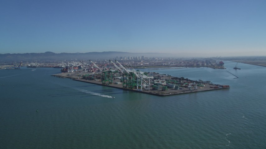5K stock footage aerial video of approaching cargo cranes at the Port of Oakland, California Aerial Stock Footage | DFKSF05_091
