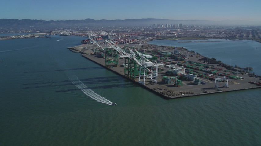5K stock footage aerial video approach large cargo cranes at the Port of Oakland, California Aerial Stock Footage | DFKSF05_092