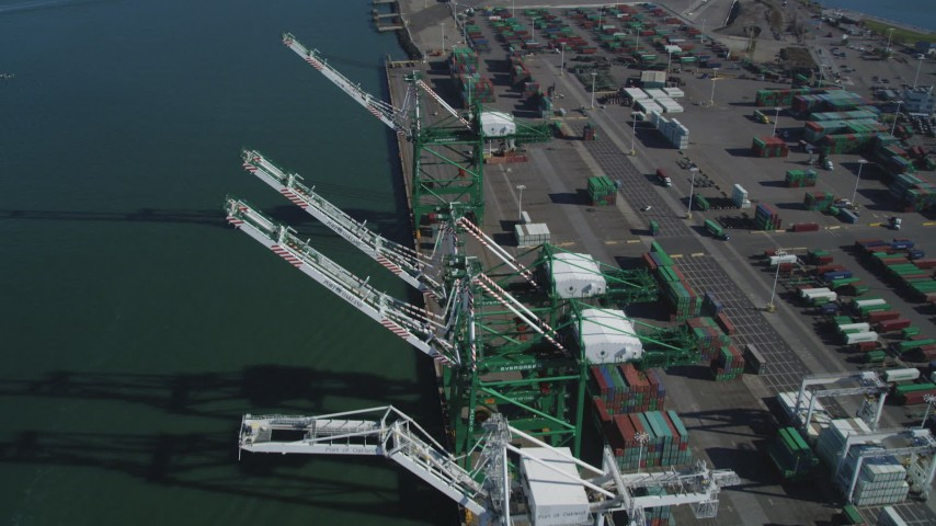 5K stock footage aerial video of flying over four cargo cranes at the Port of Oakland, California Aerial Stock Footage | DFKSF05_093