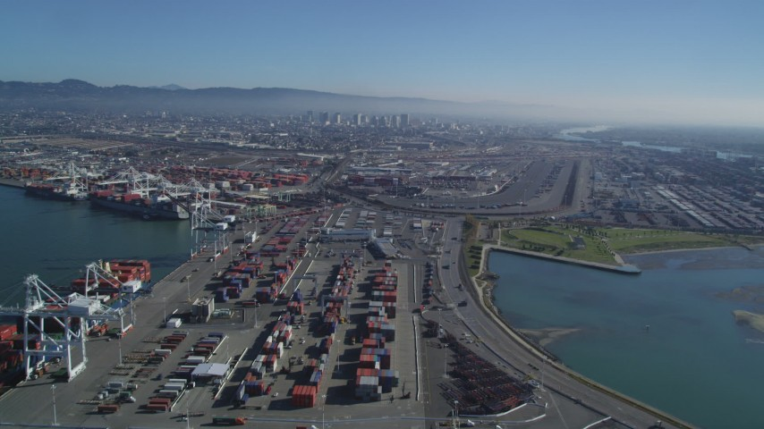 5K stock footage aerial video of panning across shipping containers and flying over the Port of Oakland, California Aerial Stock Footage | DFKSF05_094
