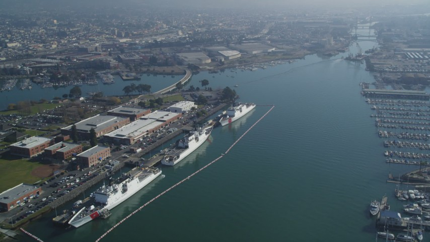 5K stock footage aerial video of flying by ships docked at Coast Guard Island, Oakland, California Aerial Stock Footage DFKSF05_097 | Axiom Images