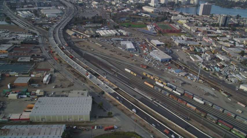 5K stock footage aerial video of flying by I-880 freeway and a train yard, Oakland, California Aerial Stock Footage | DFKSF06_008
