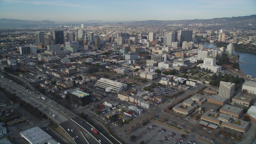 5K stock footage aerial video tilt from I-880 freeway to reveal Downtown Oakland, California Aerial Stock Footage | DFKSF06_009
