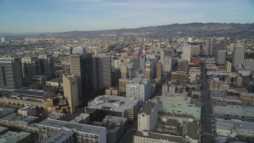 5K stock footage aerial video of tilting from the freeway to reveal office buildings in Downtown Oakland, California Aerial Stock Footage | DFKSF06_010