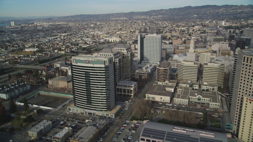 5K stock footage aerial video flyby city hall, federal and office buildings, revealing I-980 freeway, Downtown Oakland, California Aerial Stock Footage | DFKSF06_011