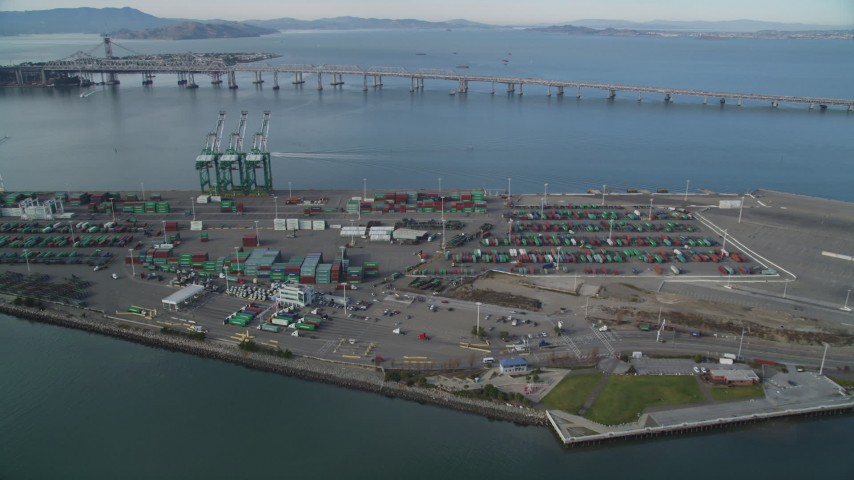 5K stock footage aerial video of approaching cargo cranes and containers at the Port of Oakland, California Aerial Stock Footage | DFKSF06_018