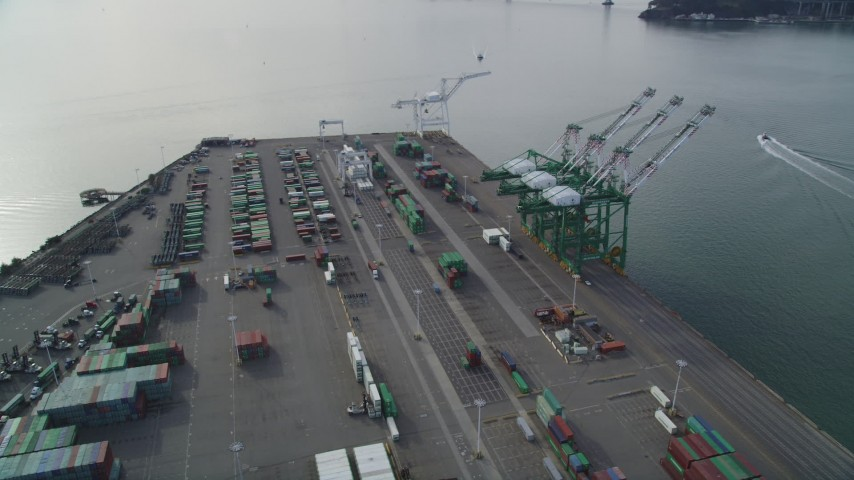 5K stock footage aerial video of an orbit of the cargo cranes and shipping containers at the Port of Oakland, California Aerial Stock Footage | DFKSF06_019