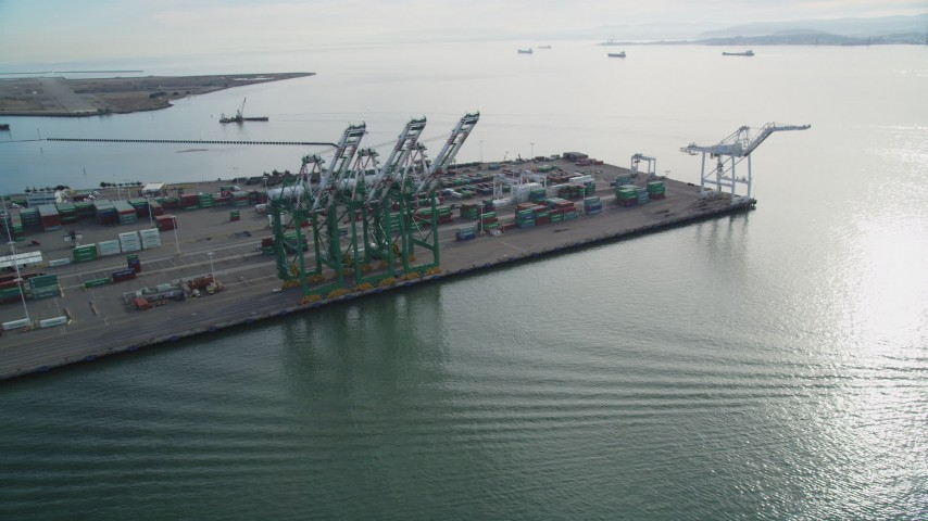 5K stock footage aerial video of orbiting the cargo cranes and shipping containers at the Port of Oakland, California Aerial Stock Footage | DFKSF06_020