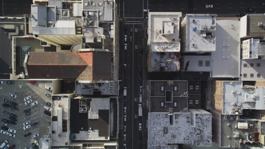5K aerial video of a bird's eye view flying over Geary Street and city buildings, Downtown San Francisco, California Aerial Stock Footage | DFKSF06_035