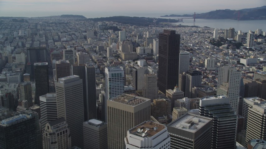 5K stock footage aerial video of flying by the city's skyscrapers with the bay in background, Downtown San Francisco, California Aerial Stock Footage | DFKSF06_047