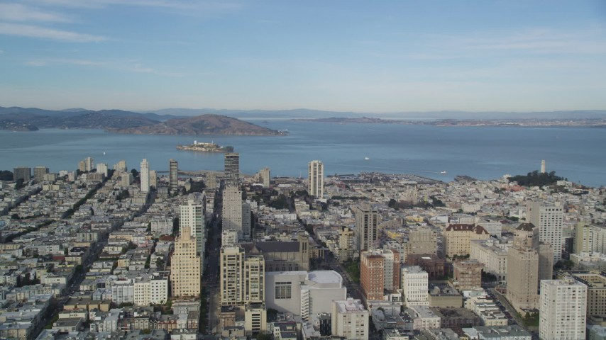 5K stock footage aerial video pan across Nob Hill, Russian Hill apartment and office buildings to reveal Coit Tower, North Beach, San Francisco, California Aerial Stock Footage | DFKSF06_050
