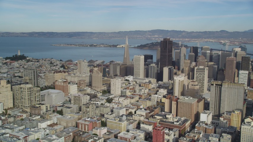 5K stock footage aerial video pan from Coit Tower in North Beach to reveal skyscrapers in Downtown San Francisco, California Aerial Stock Footage | DFKSF06_051
