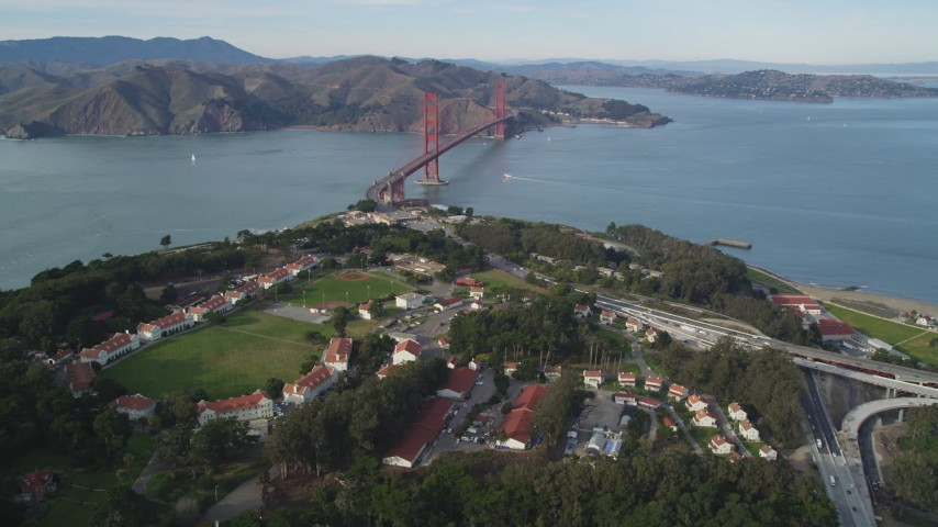 5K stock footage aerial video of flying over The Presidio, tilt to reveal the famous Golden Gate Bridge, San Francisco, California Aerial Stock Footage | DFKSF06_084