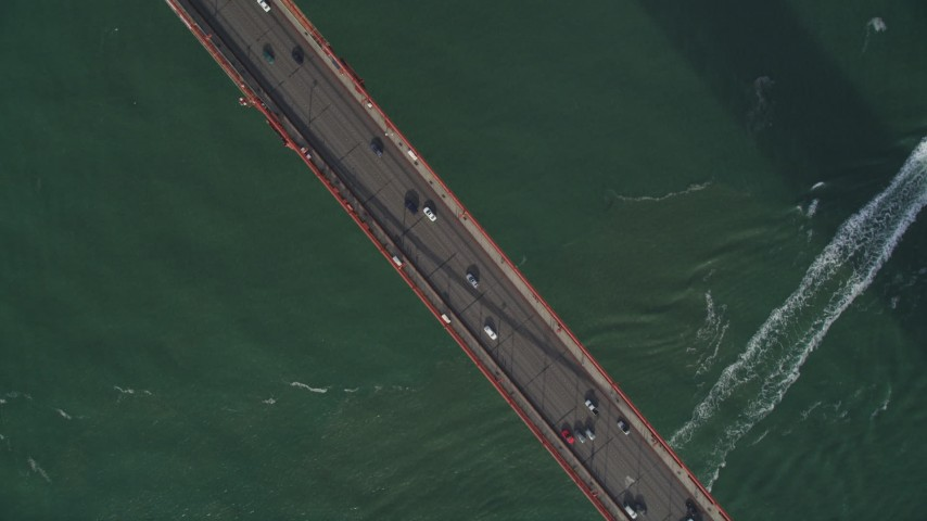 5K stock footage aerial video bird's eye view of cars crossing the famous Golden Gate Bridge, San Francisco, California Aerial Stock Footage | DFKSF06_089