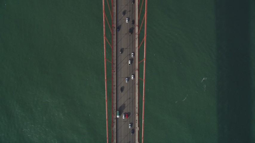 5K stock footage aerial video of a bird's eye view of traffic driving on the Golden Gate Bridge, San Francisco, California Aerial Stock Footage | DFKSF06_090