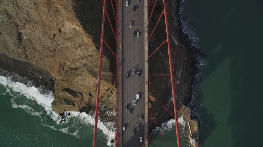 5K stock footage aerial video of a bird's eye of traffic on the Marin Hills side of Golden Gate Bridge, San Francisco, California Aerial Stock Footage | DFKSF06_092