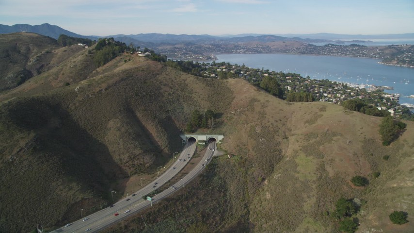 5K stock footage aerial video approach freeway and Robin Williams Tunnel (formerly  the Waldo Tunnel), Marin, California Aerial Stock Footage | DFKSF06_093