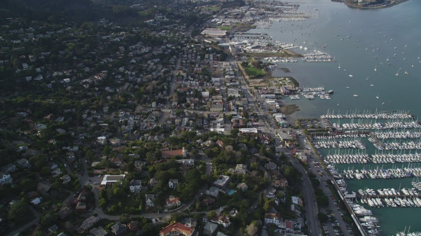 5K stock footage aerial video of flying by the coastal community of Sausalito and marinas on Richardson Bay, Sausalito, California Aerial Stock Footage | DFKSF06_095