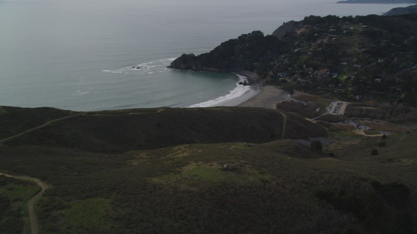 5K stock footage aerial video of panning across hills to reveal Muir Beach, Marin County, California Aerial Stock Footage | DFKSF06_102