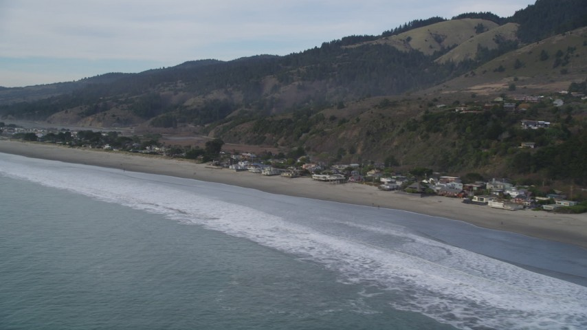 5K stock footage aerial video of flying by beachfront homes and coastal hills, Stinson Beach, California Aerial Stock Footage | DFKSF06_115