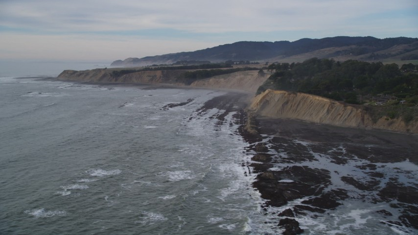 5K stock footage aerial video of flying past waves near coastal cliffs, Bolinas, California Aerial Stock Footage | DFKSF06_117