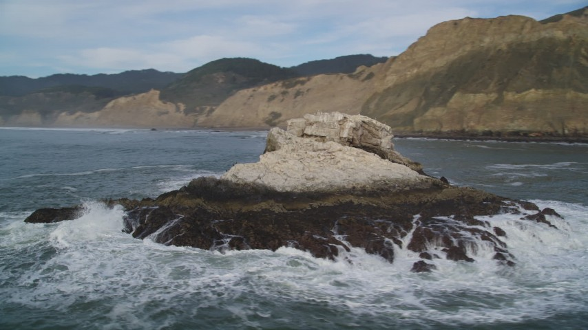 5K stock footage aerial video of circling a rock formation and ascending toward coastline, Bolinas, California Aerial Stock Footage | DFKSF06_132