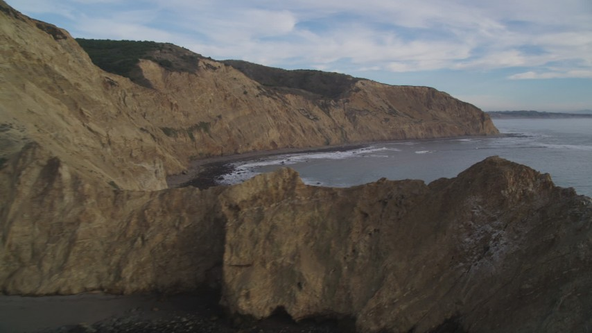 5K stock footage aerial video of panning across coastal cliffs toward the ocean, Bolinas, California Aerial Stock Footage | DFKSF06_133