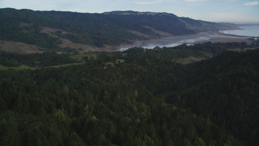 5K stock footage aerial video approach Bolinas Lagoon from forest and mountains, Point Reyes National Seashore, Olema, California Aerial Stock Footage | DFKSF06_139