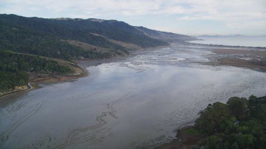 5K stock footage aerial video of flying over the Bolinas Lagoon near marshland, Bolinas, California Aerial Stock Footage | DFKSF06_142