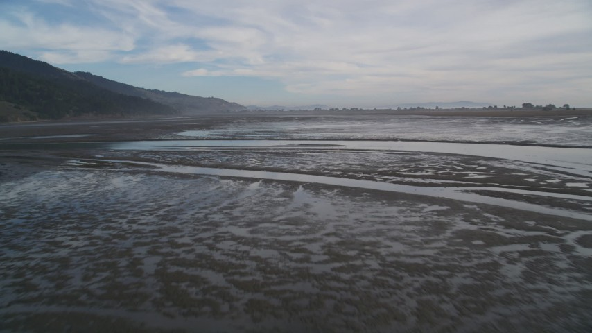 5K stock footage aerial video of flying low over the marshland at Bolinas Lagoon, Bolinas, California Aerial Stock Footage | DFKSF06_143