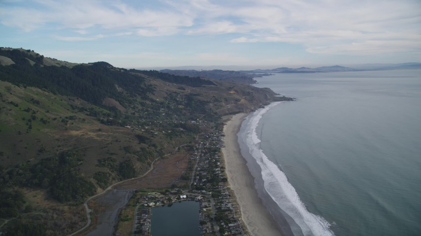 5K stock footage aerial video of flying over beachside homes on the coast, Bolinas, California Aerial Stock Footage | DFKSF06_148