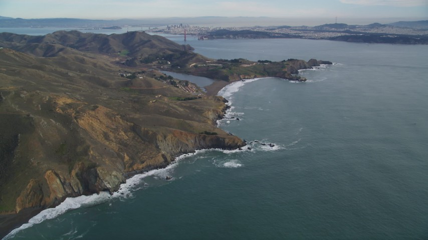 5K stock footage aerial video of flying by Marin Headlands, San Francisco in the distance, Marin County, California Aerial Stock Footage | DFKSF06_153