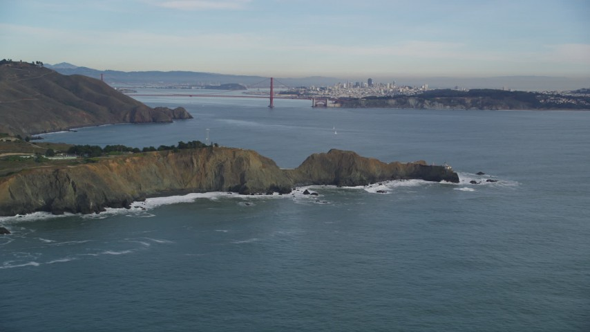 5K stock footage aerial video flyby the Marin Headlands coastal cliffs and famous Golden Gate Bridge, Marin County, California Aerial Stock Footage DFKSF06_156 | Axiom Images