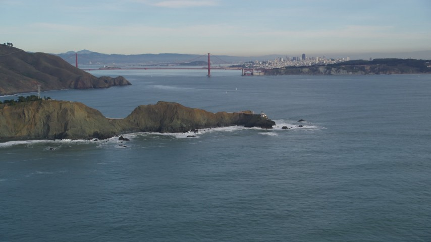 5K stock footage aerial video of a view of the Marin Headlands coastal cliffs and iconic Golden Gate Bridge, Marin County, California Aerial Stock Footage | DFKSF06_157