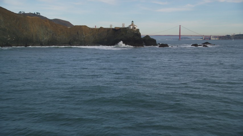 5K aerial video fly over the Point Bonita Lighthouse revealing Golden Gate Bridge, San Francisco, California Aerial Stock Footage | DFKSF06_160