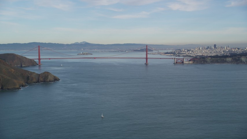5K stock footage aerial video of the Golden Gate Bridge and the Downtown San Francisco skyline, California Aerial Stock Footage | DFKSF06_161