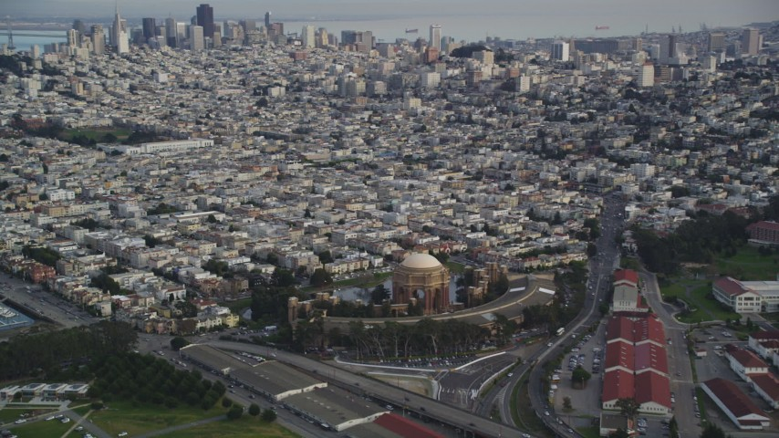 5K stock footage aerial video pan from Palace of Fine Arts to Downtown San Francisco skyline, California Aerial Stock Footage | DFKSF06_165